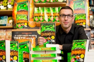 29/01/2015 Pictured here is Shane Hegarty at the signing of his debut children's novel, Darkmouth, in Eason O'Connell Street. Hegarty's book, Darkmouth, is currently on sale in Eason stores nationwide and online at www.easons.com retailing at €11.99. Picture Andres Poveda For further information, please contact:  Kristin Fox @ Wilson Hartnell 087 221 1916 / 01 669 0030 kristin.fox@ogilvy.com
